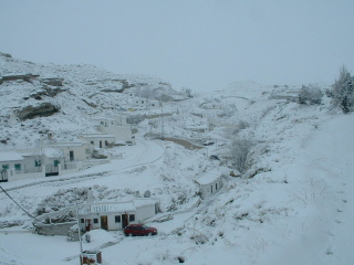 cave houses in the snow